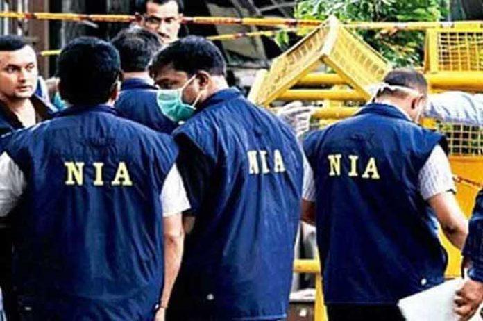 NIA Officials