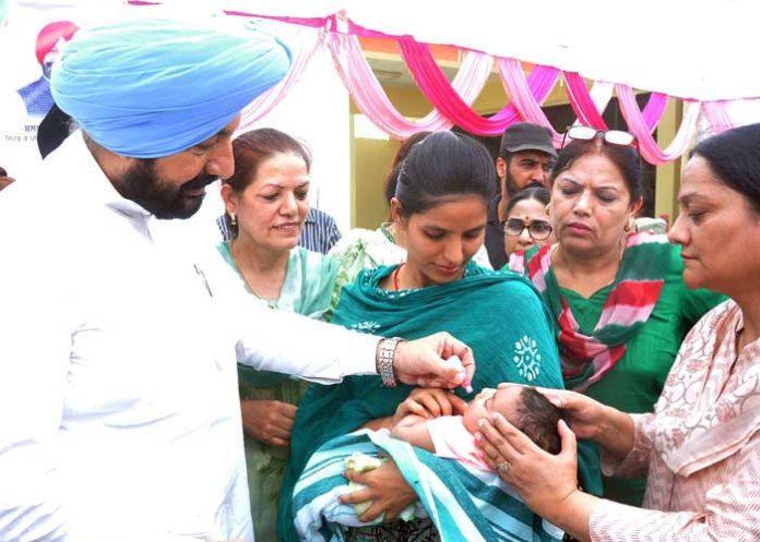 Balbir Sidhu giving Rotavirus Vaccine