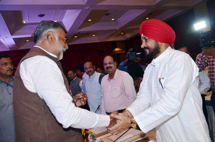 Charanjit Channi Prahlad Patel Handshake Delhi