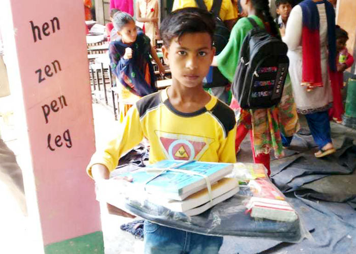 Cheema donate Books flood family kids 3