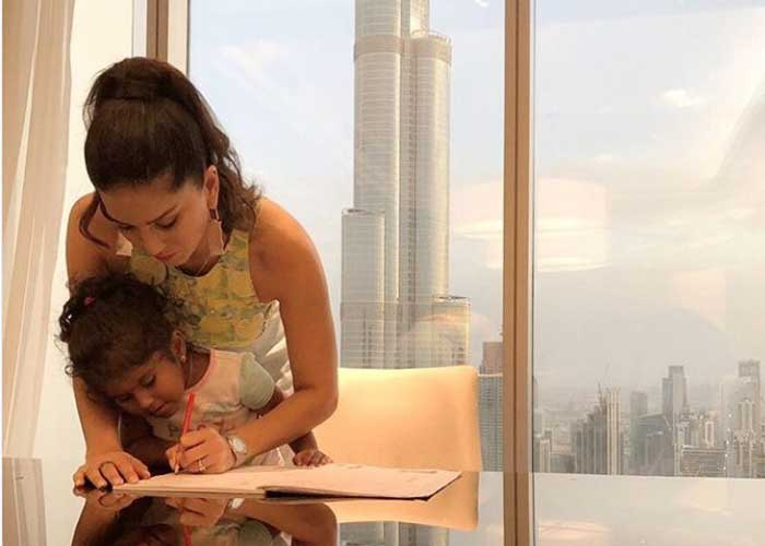 Sunny Leone doing daughter homework