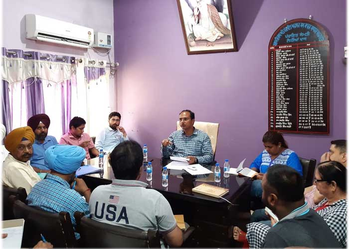 Varinder Sharma Dept Meeting about flood