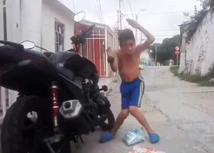 boy danciing on bike anti theft alarm