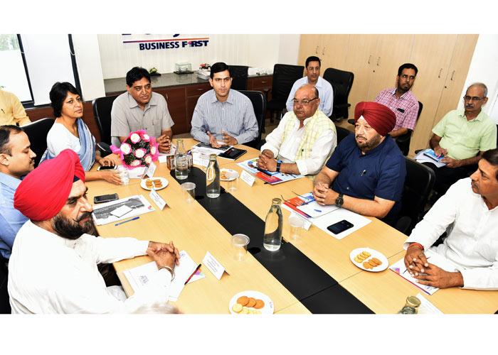 Sham Sunder Arora Vini Mahajan at meeting
