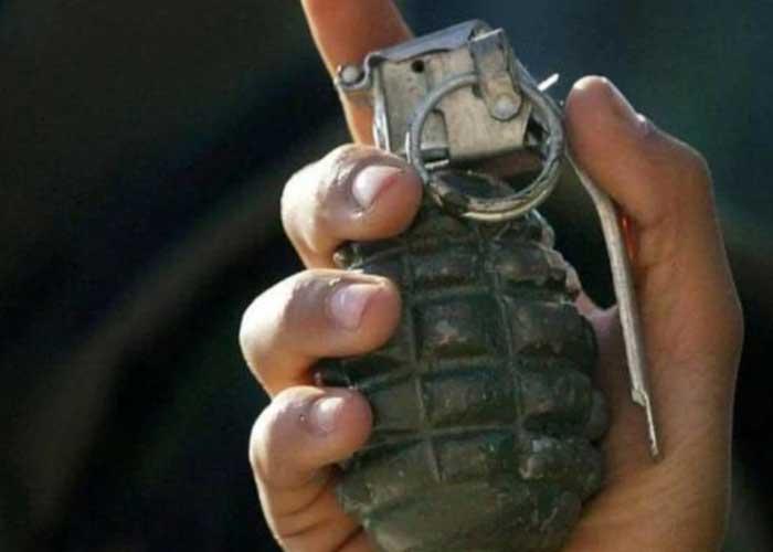 Grenade in hand