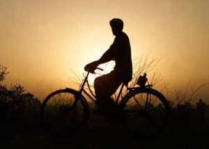 Farmer Man on Cycle