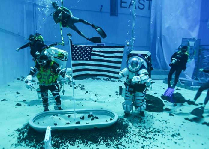 NASA astronauts preparing for moonwalks