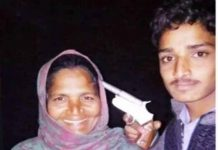 Youth poses with gun at his mother head