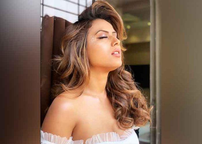 Nia Sharma turns white angel