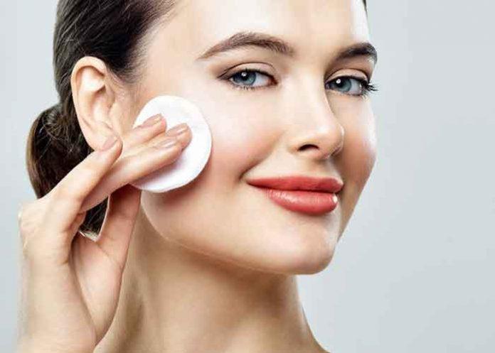 Woman using skin toner