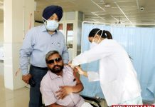 Karuna Raju takes COVID shot
