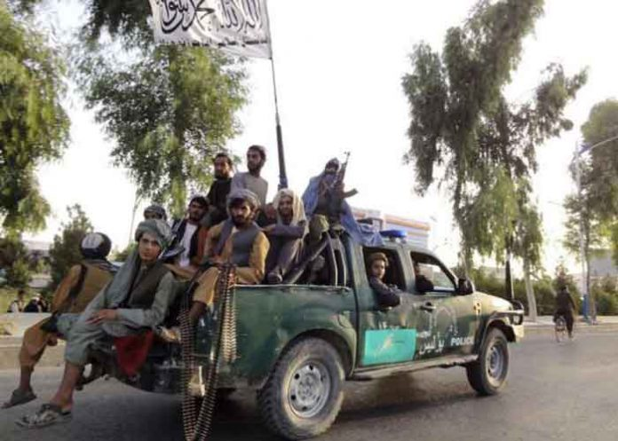 Taliban Fighters on Afghan Roads