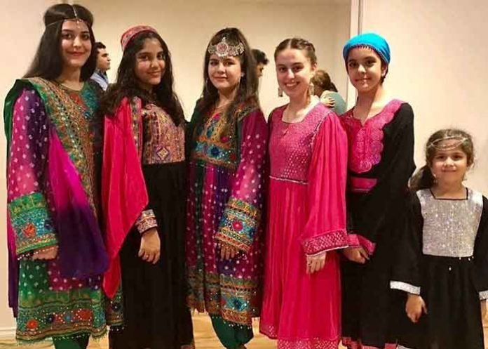 Afghan women protest by sharing colourful dresses