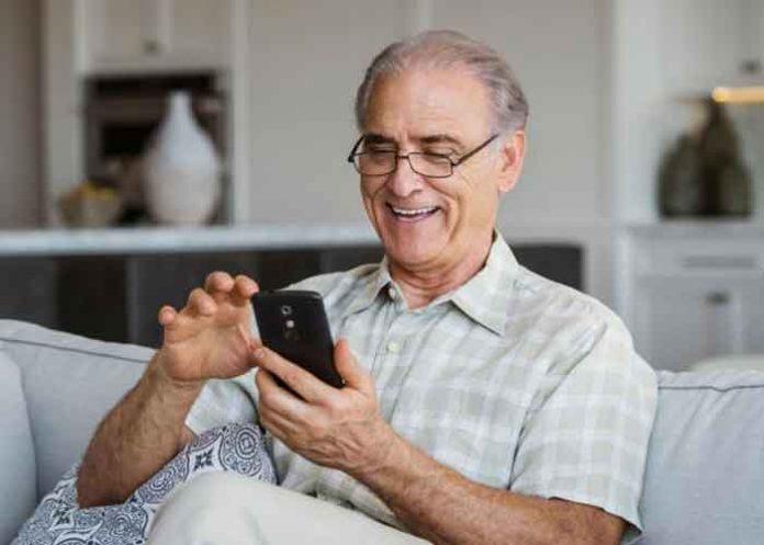 Elderly senior citizen using phone
